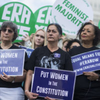 UNITED STATES - JUNE 6: Jessica Lenahan, center, a domestic violence survivor, and Carol Jenkins, right, of the Equal Rights Amendment Task Force, attend a news conference at the House Triangle on the need to ratify the Equal Rights Amendment on June 6, 2018. (Photo By Tom Williams/CQ Roll Call)